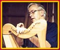 Keith Harrison working on one of his harps.